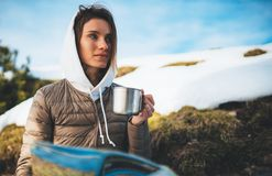 People planning trip in snow mountain, girl hold in hands cup of drinks, relax tourist look on map, hipster enjoy on background. Winter nature, journey royalty free stock photography