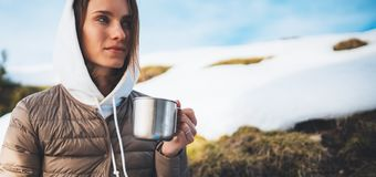 People planning trip in snow mountain, girl hold in hands cup of drinks, relax tourist look on map, hipster enjoy on background. Winter nature, journey stock photo