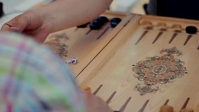People play backgammon. Close up shot of two people playing backgammon. This round is mine stock video footage