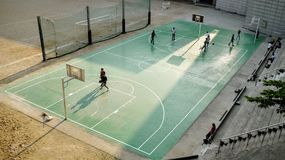 People Play Basketball at Daytime Stock Photography