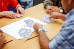 People play cards Stock Images