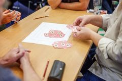 People play cards Royalty Free Stock Photos