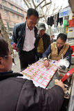 People play Chinese Chess in a street. Unidentified people play Chinese Chess in a street on March 18, 2016 in Shanghai, China. Xiangqi, also called Chinese Royalty Free Stock Photo