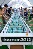 People play in an extra large foosball (also know as table soccer and table football)  at Sonar Festival Royalty Free Stock Photo