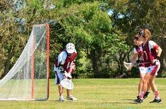 People play field hockey game stock photo
