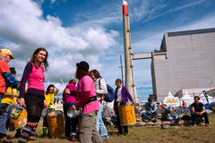 People play music on the festival against the Nuclear Power Plant Royalty Free Stock Images