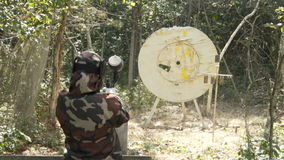 People play paintball in the woods. 60 fps stock video