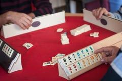People play  popular logic table game rummikub Stock Photo