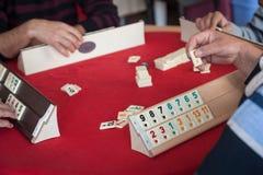 People play  popular logic table game rummikub Stock Images