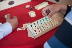 People play  popular logic table game rummikub. People play very popular logic table game rummikub Stock Photography