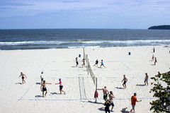 People play volleyball on the beach Stock Images