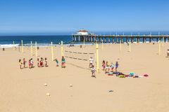 People play volleyball and train at the beach Royalty Free Stock Image