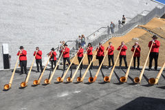 People playing the alphorn at Mount Generoso on Switzerland Royalty Free Stock Images