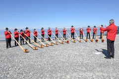 People playing the alphorn at Mount Generoso on Switzerland Stock Image