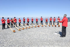 People playing the alphorn at Mount Generoso on Switzerland Stock Images