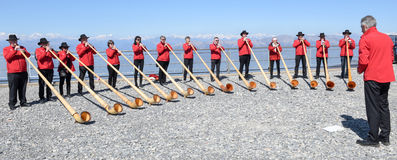 People playing the alphorn at Mount Generoso on Switzerland Royalty Free Stock Image