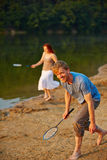People playing badminton on vacation Stock Photography