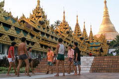 People playing with a ball in the area of the Shwedagon Pagoda i Stock Photography