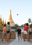 People playing with a ball in the area of the Shwedagon Pagoda i Royalty Free Stock Photography