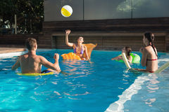People playing with ball in swimming pool Royalty Free Stock Images
