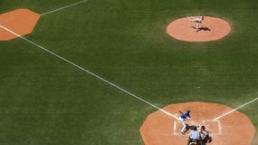People Playing Baseball in Baseball Field Royalty Free Stock Photography