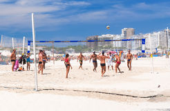 People playing beach volleyball on Copacabana beach in Rio de Janeiro Stock Image