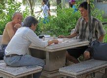 People are playing board game in Bangkok, Thailand. Bangkok, Thailand - May 11, 2015: people are playing board game in Bangkok, Thailand Stock Photos