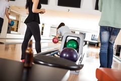 People Playing in Bowling Alley Stock Photography