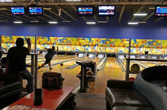 People playing bowling in a bowling saloon Stock Photo