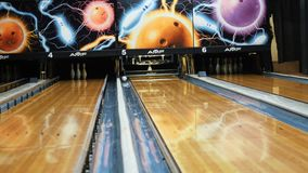 People playing bowling - colorful ball hitting the bowling pins on bowling alley in a sport club. Media. The bowling. People playing bowling - colorful ball stock footage