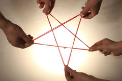 People playing cats cradle game Royalty Free Stock Images