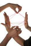 People playing cats cradle game. Close-up royalty free stock images