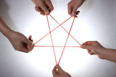 People playing cats cradle game,close-up Royalty Free Stock Images