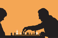 People playing chess. Silhouette of people playing chess Stock Image