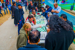 People playing chess in the streets of Bogota. BOGOTA, COLOMBIA - FEBRUARY 9, 2015: People playing chess in the streets of Bogota Stock Photo