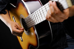 People playing classic guitar. Close up people playing classic guitar on dark room Royalty Free Stock Images