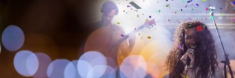 People playing at concert with transition. Digital composite of people playing at concert with transition Royalty Free Stock Image