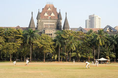 People playing cricket in the central park at Mumbai Stock Photos