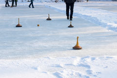 People playing curling on a frozen lake, Austria, Europe Royalty Free Stock Photo