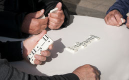 People  playing domino game for leisure Stock Image