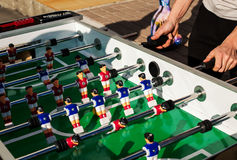 People Playing Enjoying Football Table. Soccer Game Recreation Leisure Stock Photo