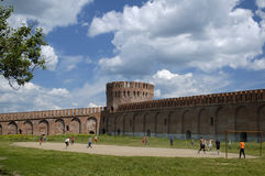 People playing footbal. The fortress wall and tower in Smolensk. People playing football. Russia Stock Image