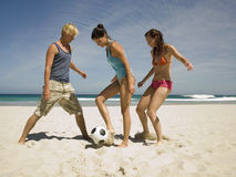 People playing football on the beach Royalty Free Stock Image