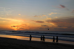 People playing football at the beach in Brazil during sunset. They are in Fernando de Noronha located in Northwest Brazil. Fernando de Noronha is one of the Stock Photography