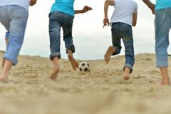 People playing football on a beach Royalty Free Stock Photos