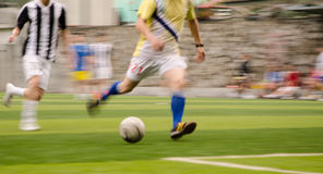 People are playing football stock image