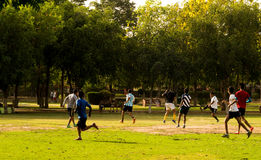 People playing football in Gurgaon. Gurgaon, India ; 23rd May 2015: Peopel playing football in a park in Gurgaon, Haryana. People are increasingly opting for Royalty Free Stock Image
