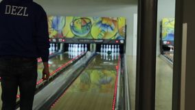 People playing a game of bowling at the small town bowling alley in Kiev, Ukraine, 02.12.2017 stock footage