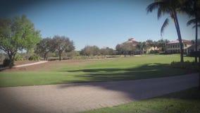 People playing a game of golf Daytona Beach, Florida stock video