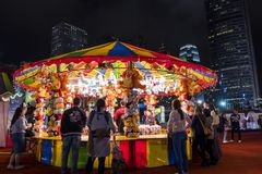 People playing games in a large carnival in the heart of financial center of Asia. Stock Photo
